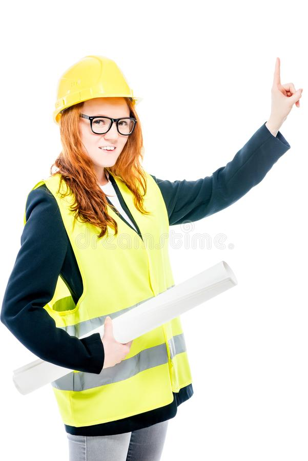 Woman in vest and yellow helmet on white background. In studio posing stock images