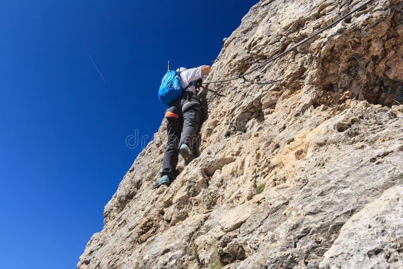 Woman on via ferrata stock photo