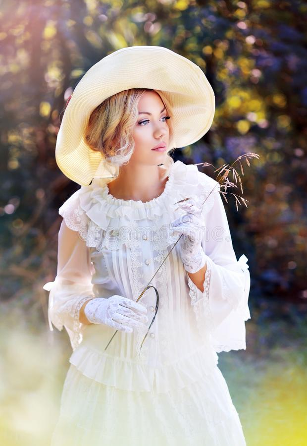 Woman in victorian age outdoo. Portrait of beautiful woman in victorian age dress and fancy hat walking outdoor royalty free stock photos