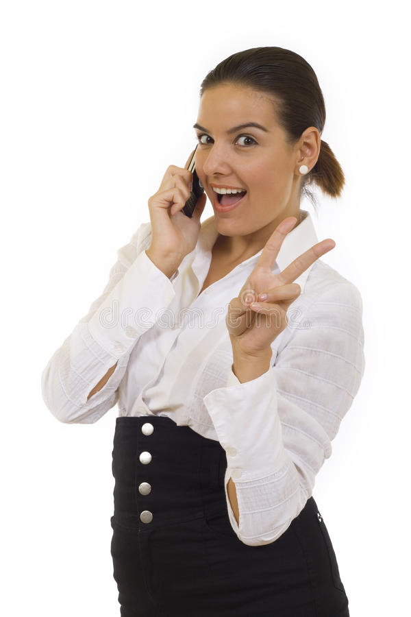 Woman with victory gesture and mobile phone. Business woman with victory gesture and mobile phone stock photography