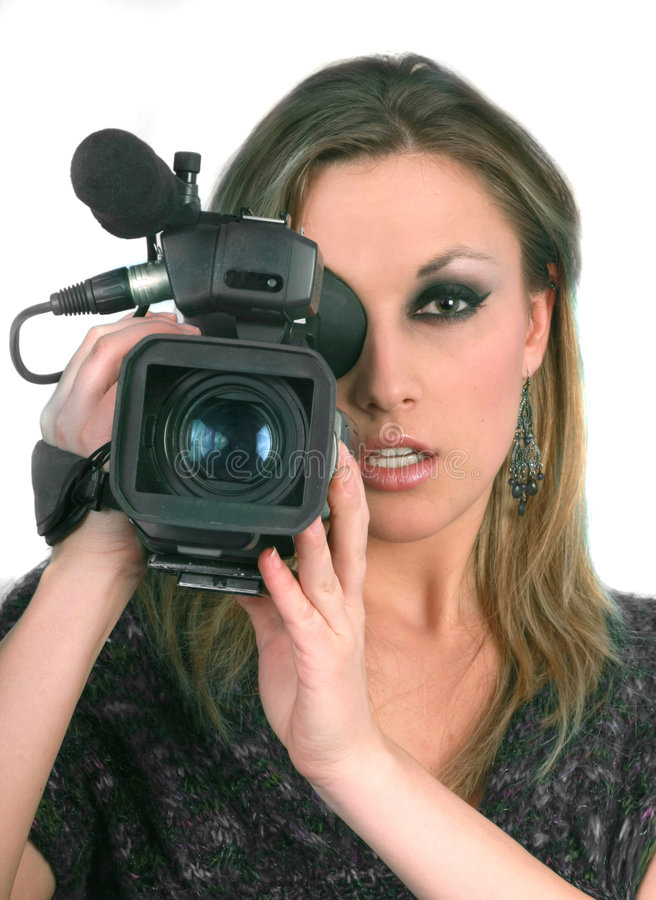 Woman with video camera on blue screen royalty free stock photography