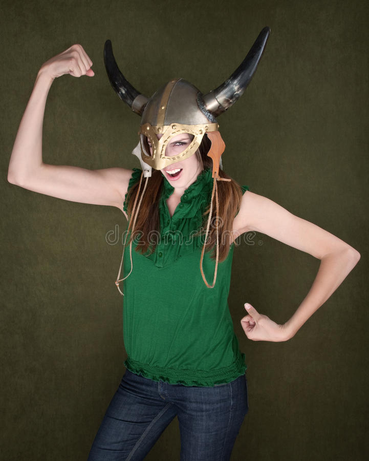 Woman in Viking Helmet Flexes Her Muscles