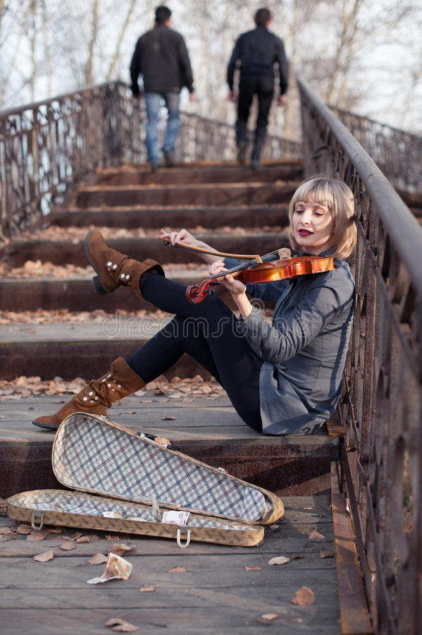 Woman with viola on the bridge royalty free stock photo