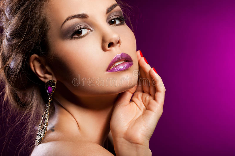 Woman with violet jewelry stock photography