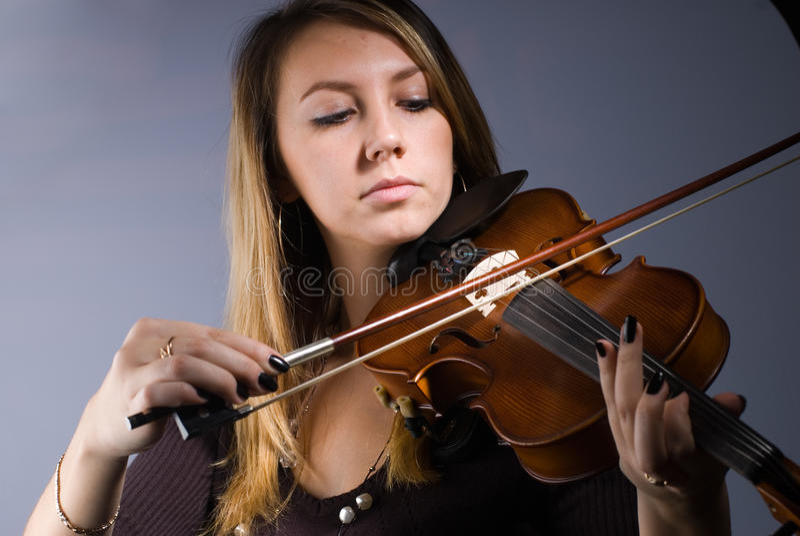 Woman and violin royalty free stock image