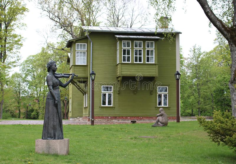 Woman violinist made of metal is installed in the park of the Latvian city of Kuldiga. May 2019 stock image