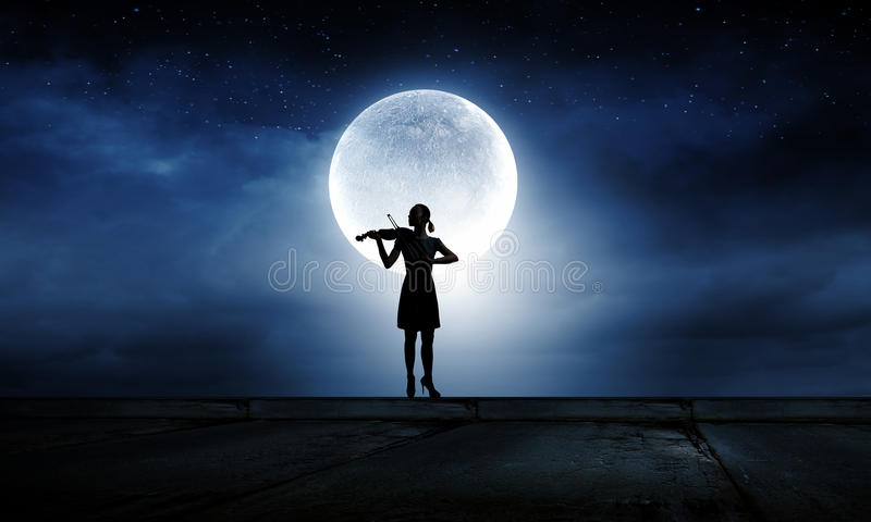 Woman violinist royalty free stock photo