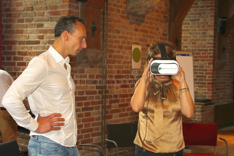 Woman virtual reality experience, Netherlands. Woman experiences virtual reality glasses during a workshop in the castle of Nyenrode University in Breukelen royalty free stock images