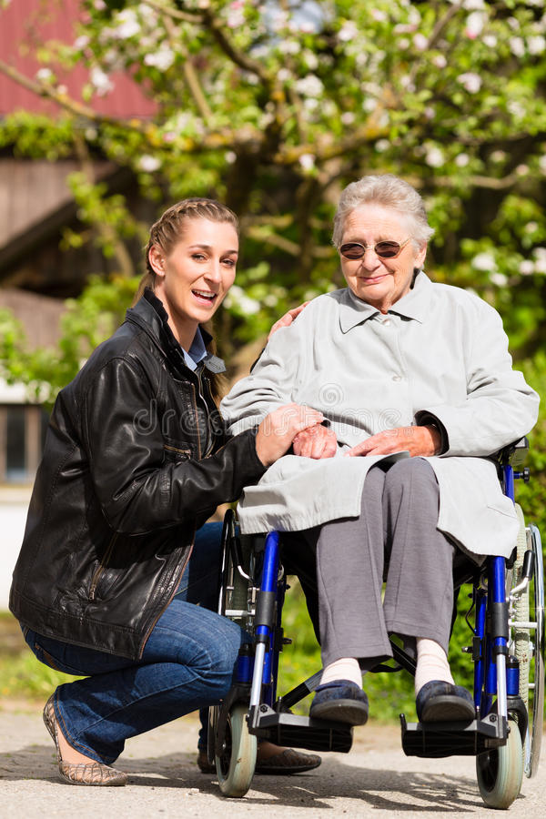 Woman visiting grandmother in nursing home. Young women is visiting her grandmother in nursing home stock photo