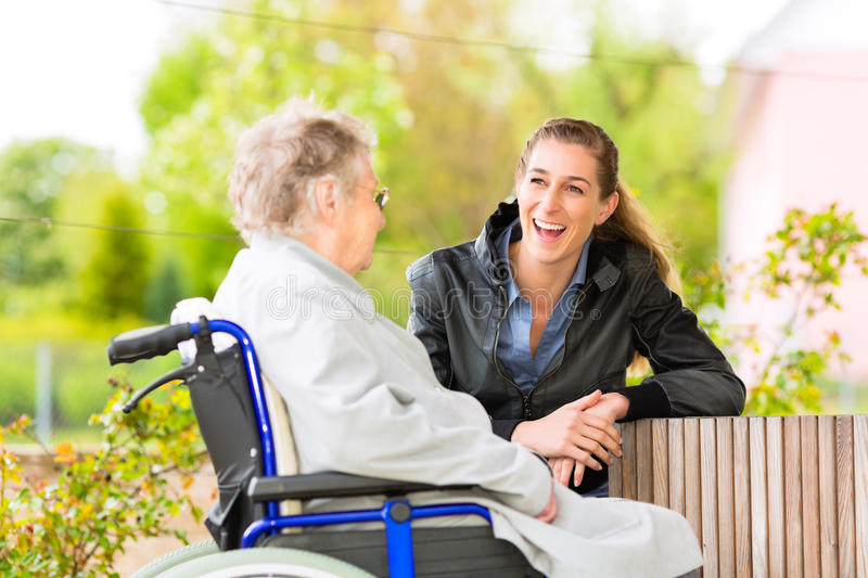 Woman visiting her grandmother. Young woman is visiting her grandmother in nursing home royalty free stock images