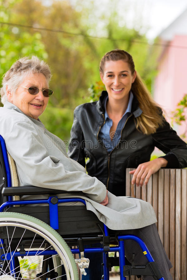 Woman visiting her grandmother. Young woman is visiting her grandmother in nursing home stock images