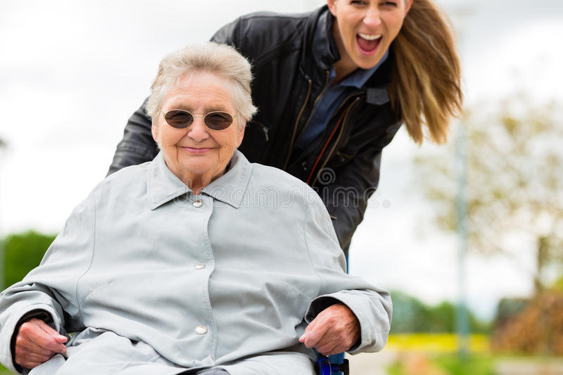Woman visiting her grandmother. Young woman is visiting her grandmother in nursing home stock image