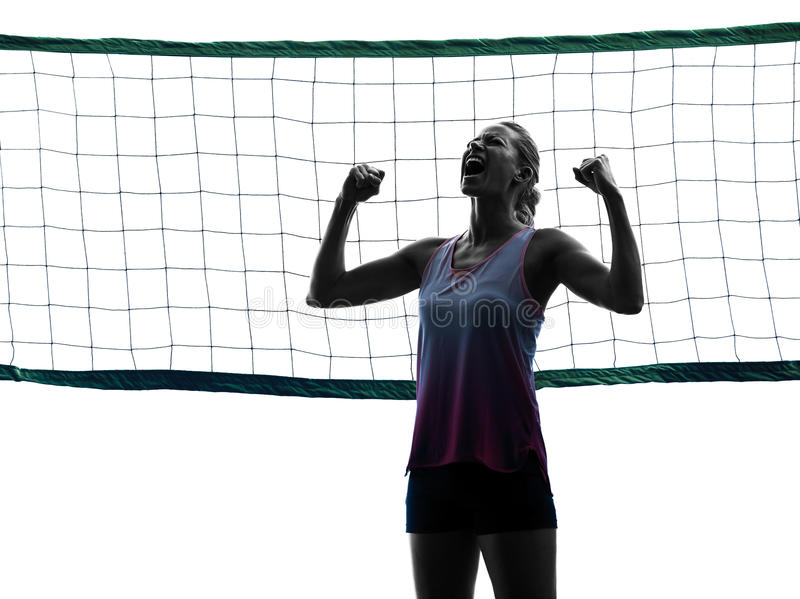 Woman volleyball players isolated silhouette. One caucasian woman volleyball in studio silhouette isolated on white background royalty free stock images