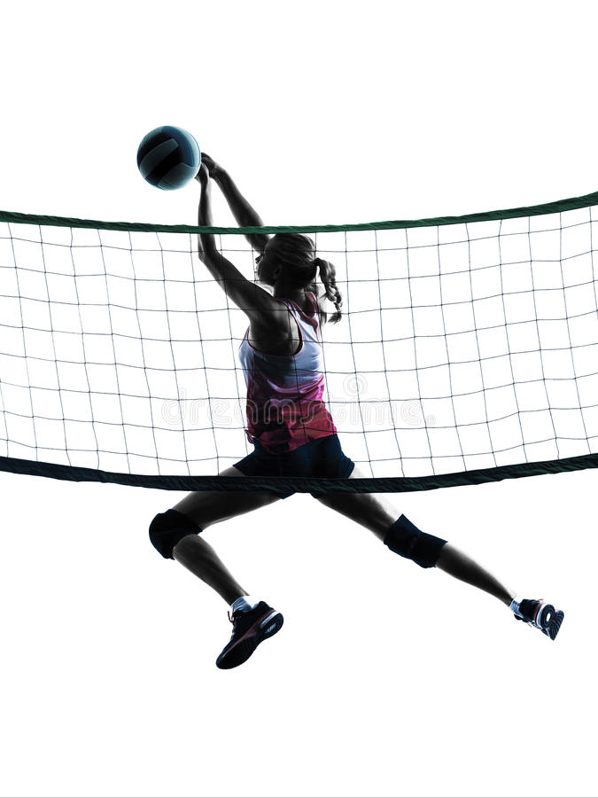 Woman volleyball players isolated silhouette. One caucasian woman volleyball in studio silhouette isolated on white background royalty free stock image