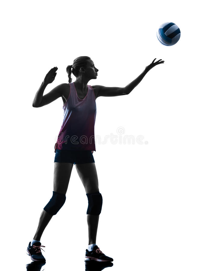 Woman volleyball players isolated silhouette. One caucasian woman volleyball in studio silhouette isolated on white background royalty free stock photography