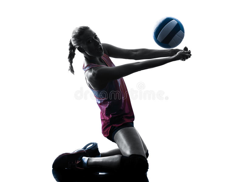 Woman volleyball players isolated silhouette. One caucasian woman volleyball in studio silhouette isolated on white background royalty free stock photos