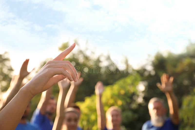 Woman at volunteers meeting. Group of people outdoors stock photography