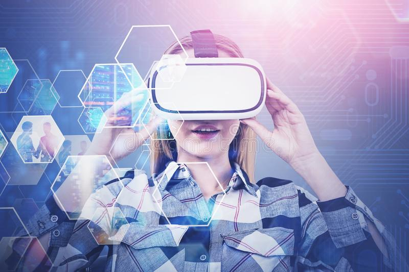 Woman in VR glasses, streaming video interface. Smiling astonished blonde woman in VR glasses looking at streaming images. Future and hi tech of entertainment royalty free stock photos