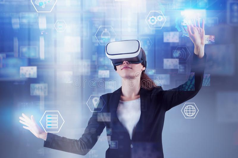Woman in VR headset, information interface stock images