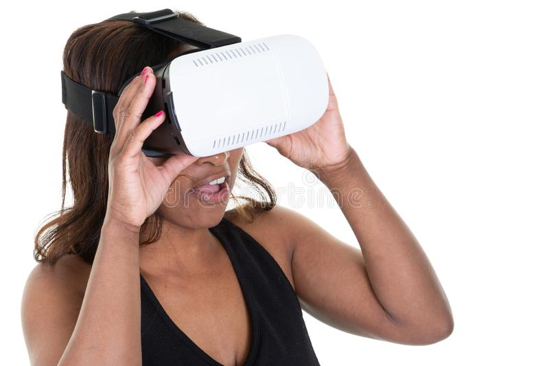 Woman in VR headset looking up and trying to touch objects on white background stock photography