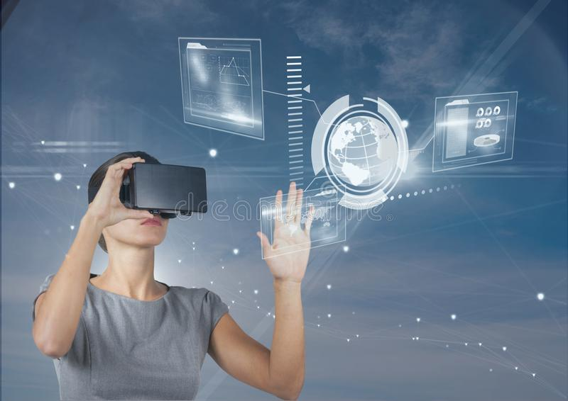 Woman in VR headset touching interface against blue sky with stars royalty free stock photo