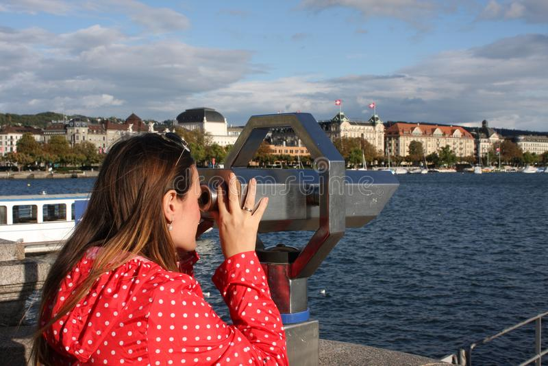 Woman waching a landmarks od Zurich in Swiss. stock image