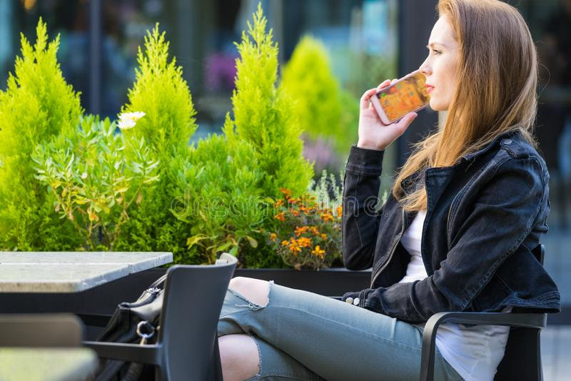 Woman wait in outdoor cafe., make phone call royalty free stock photos