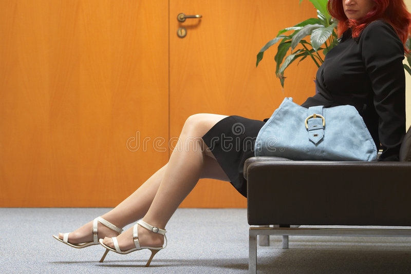 Woman in the waiting area stock images