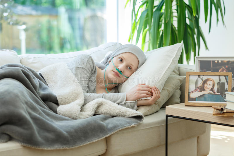 Woman waiting for cancer remission stock photography