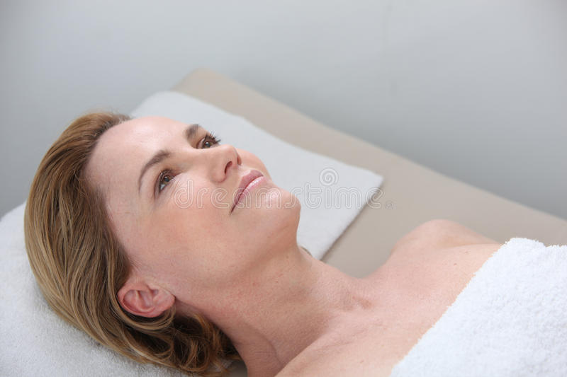 Woman waiting for massage stock photos