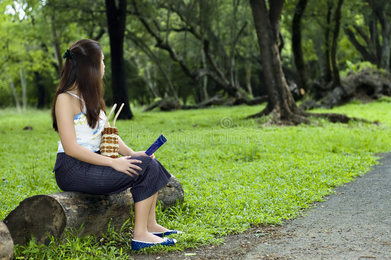 Woman waiting at park stock image