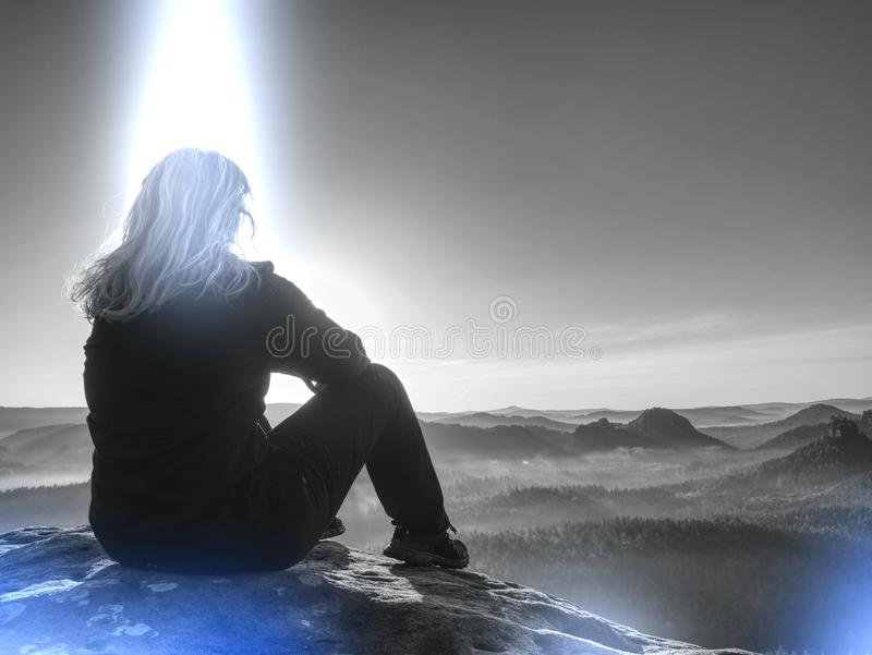 Woman is waiting for sunrise. Abstract of freedom and Peaceful stock photography