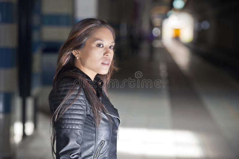 Woman waiting on a train stock photography