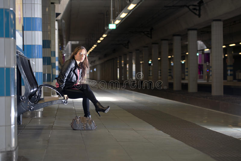 Woman waiting for a train stock images