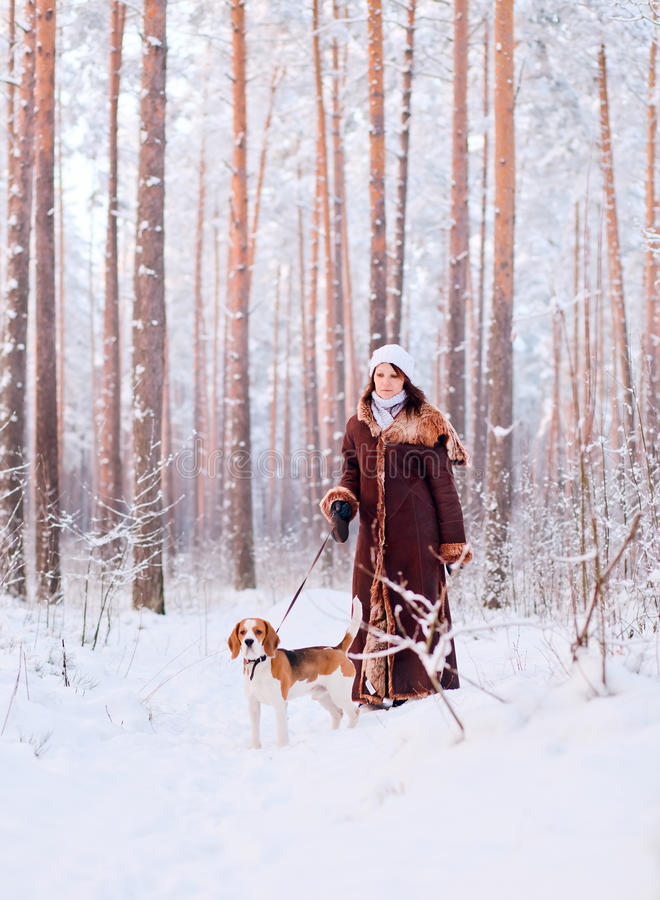 Woman walk with dog. The woman walk with dog in forest royalty free stock image