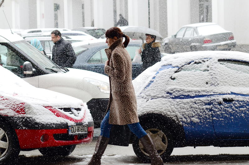 Woman walk in the snow fall stock photos