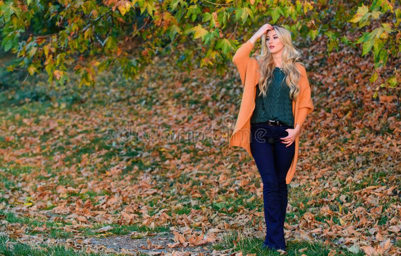 Woman walk sunset light. Cozy casual outfits for late fall. Comfortable outfit. Girl adorable blonde posing in warm and. Cozy outfit autumn nature background stock photos
