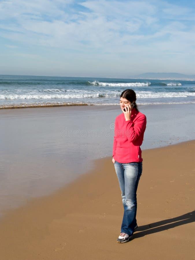 Woman walking alone royalty free stock photo