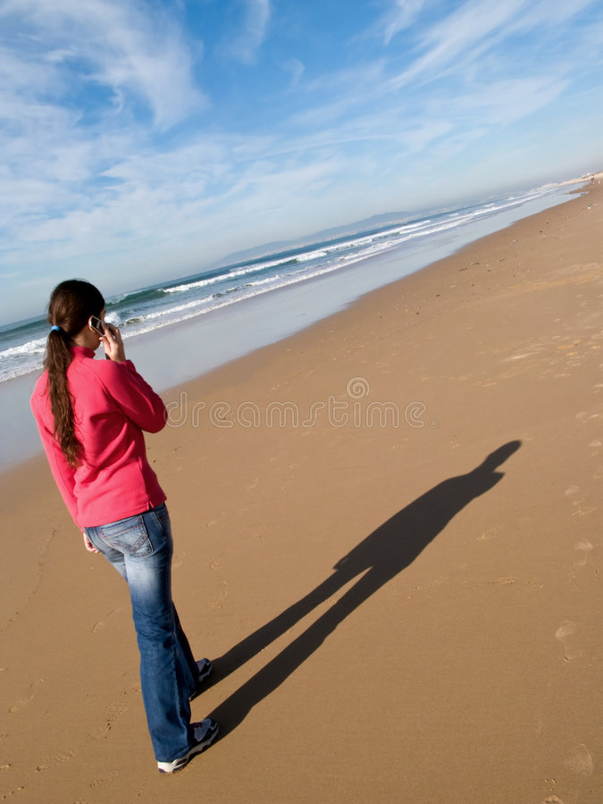 Woman walking alone royalty free stock photography