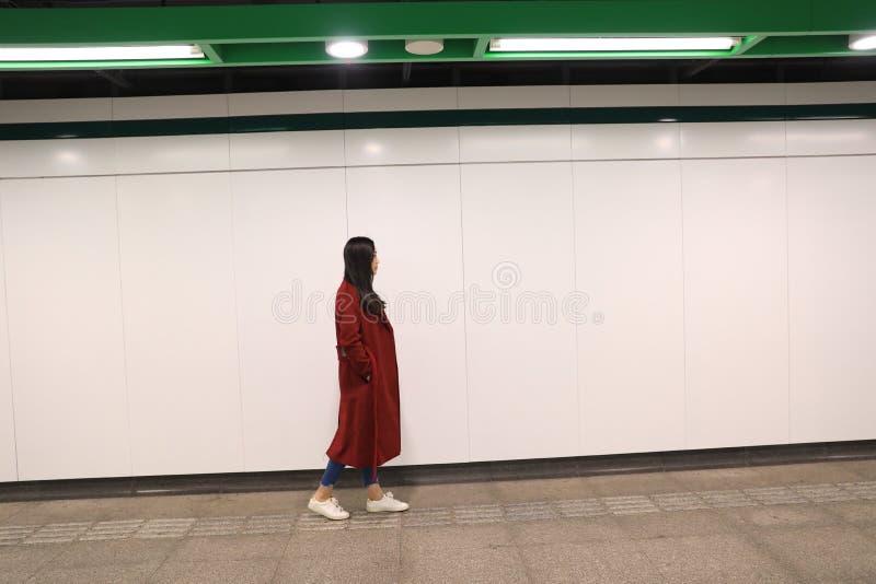 Woman walking alone at night. View of woman walking alone at night royalty free stock photo