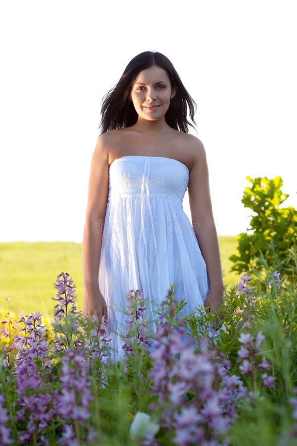 Woman Walking Along The Field Royalty Free Stock Image