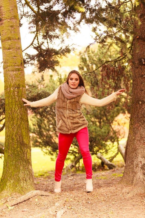 Woman walking in autumn park stock photos