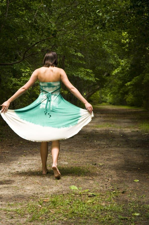 Woman Walking Barefoot Stock Photos