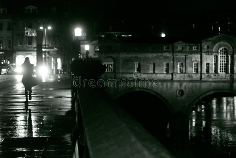Woman walking in Bath on a rainy night royalty free stock photos