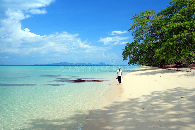 Woman walking on beach. Woman walking on Andaman beach with white sand and clear blue water stock images
