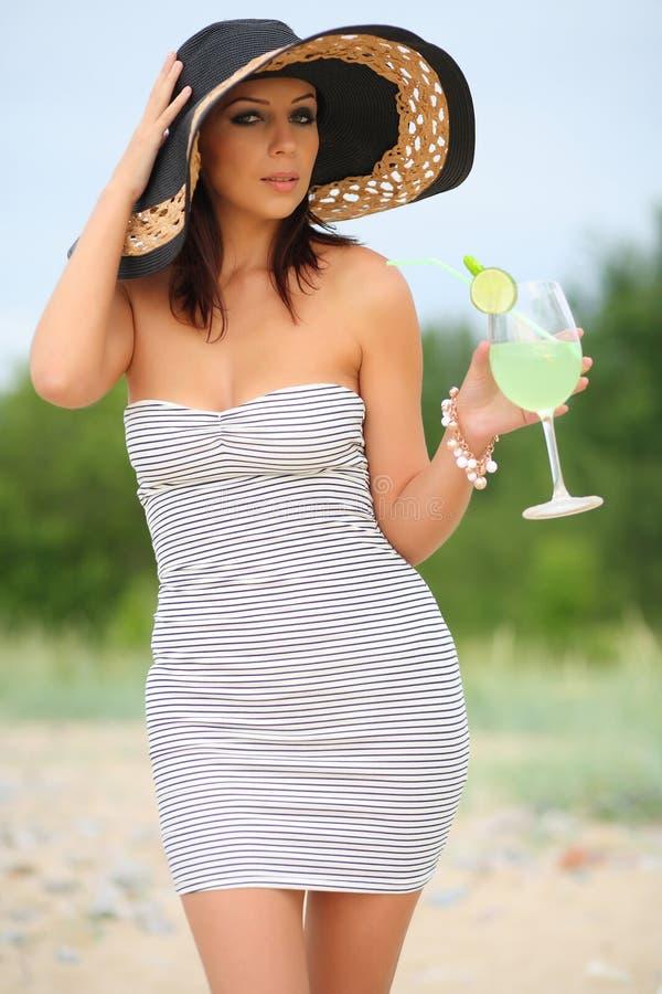 Woman walking on the beach stock image