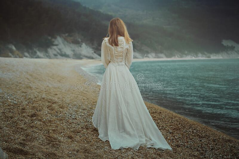 Woman walking on the beach royalty free stock photos