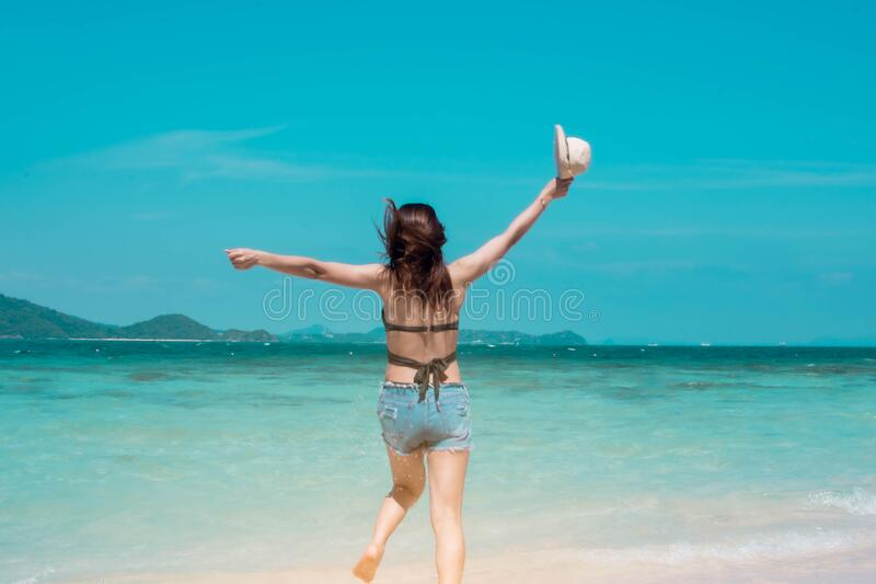 Woman walking on the beach royalty free stock image