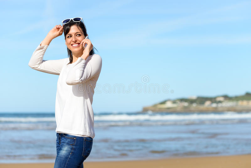 Woman walking and calling on cell phone royalty free stock photos