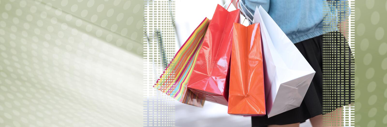 Woman walking and holding shopping bags; panoramic banner royalty free stock images